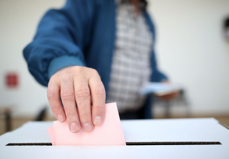 Man casts his ballot at elections