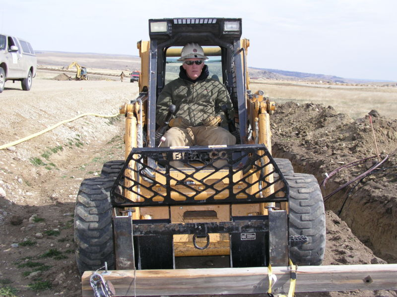 Employee sitting in bulldozer