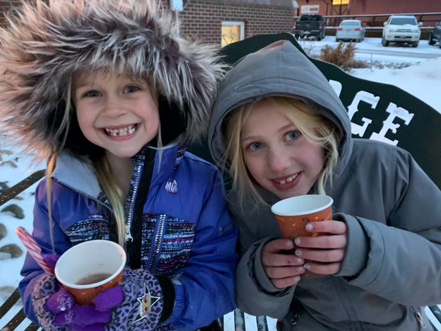 Girls outside drinking hot apple cider